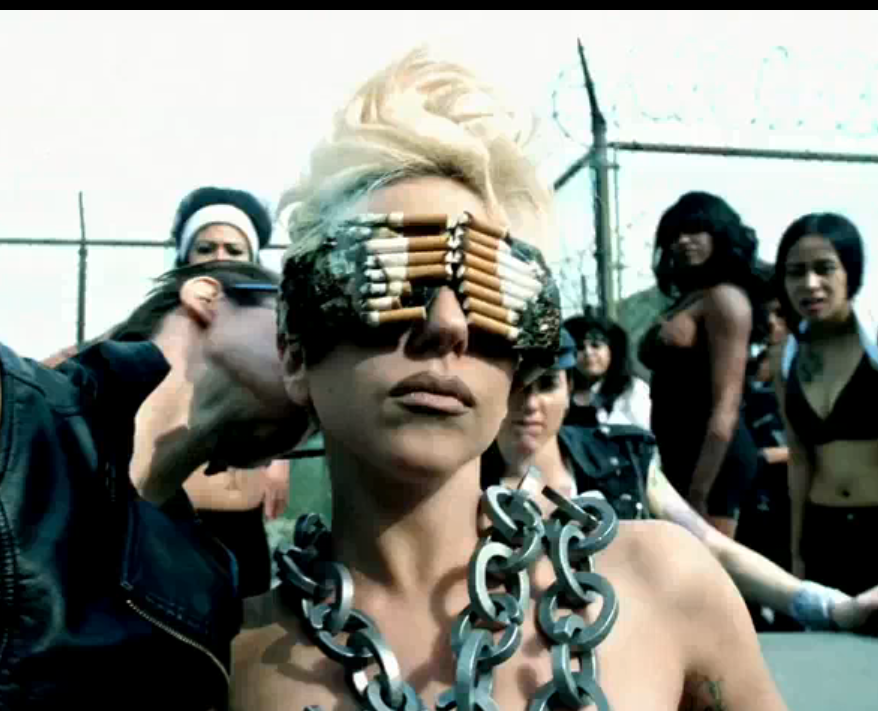 95b6c2276d3ec Lady Gaga is smoking in her cigarette sunglasses and chains. Putting aside  the possible danger ...